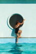 child climbs on the edge of the pool
