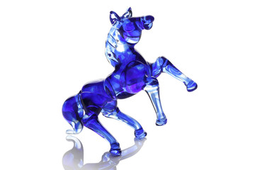 Glass blue horse isolated on white.