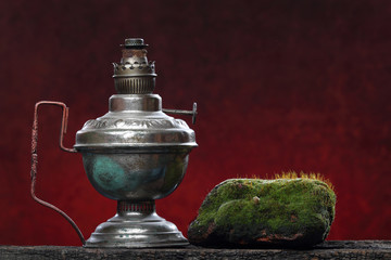Old iron lamp still life. Ecologic concept