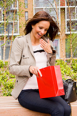 a young woman looking surprised at receiving a gift.