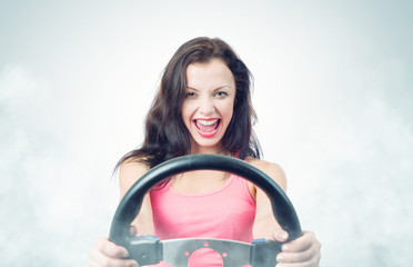 Funny girl with car wheel and smoke