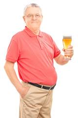 Joyful senior holding a pint of beer