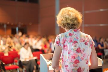 Female academic professor lecturing.