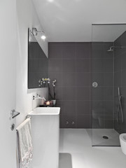 interior view of modern bathroom with glass shower cubicle