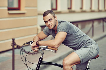 Handsome man on a bicycle