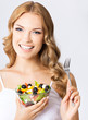 canvas print picture - Woman with vegetarian salad, over gray
