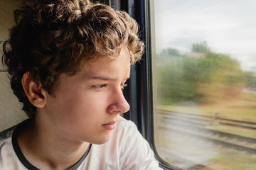 Teenage boy in the train