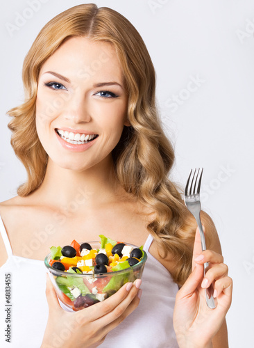 canvas print picture Woman with vegetarian salad, over gray