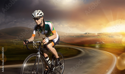 canvas print picture Motion road cyclist