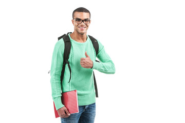 Young smiling student carrying bag.
