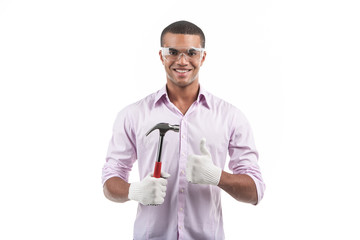African american man holding hammer.