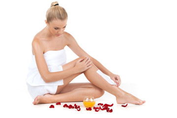 depilation of female legs with waxing on white background.