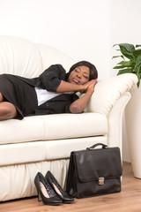 Side View Of Woman Sleeping On Sofa.