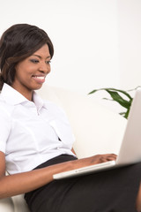 young black girl with laptop computer.