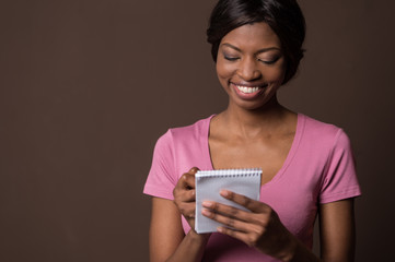 Smiling young elegant woman looking away.