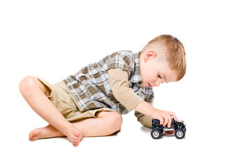 Beautiful boy playing toy car