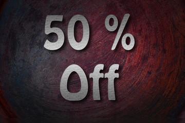 """50% off"" handwritten with white chalk on a blackboard"