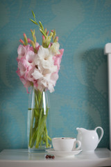beautiful gladiolus bouquet and coffee cup