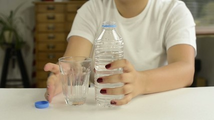 young girl drink a water