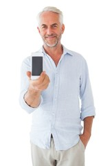 Smiling man showing smartphone to camera