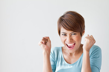 smiling, happy, positive, excited woman on plain background, wit