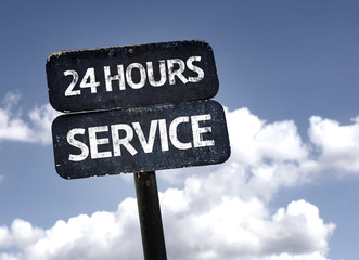 24 Hours Service sign with clouds and sky background