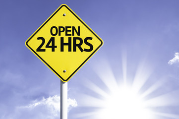 Open 24Hrs road sign with sun background
