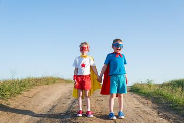 children acting like a superhero