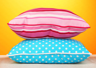 Blue bright pillows on orange background
