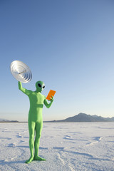 Green Alien Man Holding Tablet and Satellite Dish