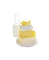 cheese and milk in ceramic dish on white background