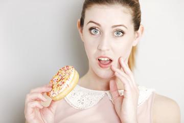 Woman eating a doughnut