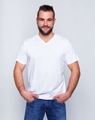 Young handsome man in a white t-shirt