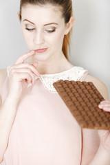 Woman enjoying a chocolate bar