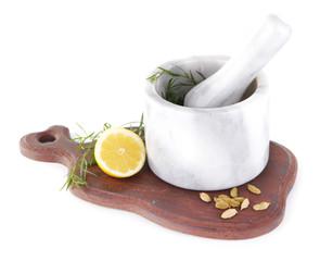 Estragon with lemon and cardamom in mortar pounder