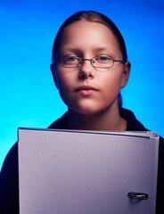 Young student in glasses holds folder