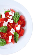 Salad with watermelon, feta and basil leaves