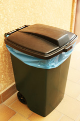 Recycling bin on wall background