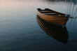 Row boat in calm water - 68847905
