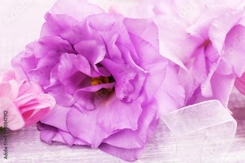 Leinwandbild Motiv beautiful chrysanthemum and artificial eustoma flowers, close
