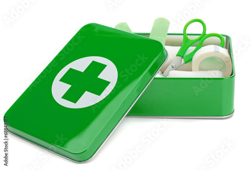 An open first aid box with contents on a white background - 68848187