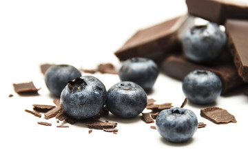 Blueberries with chocolate isolated on white background