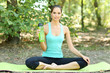 Young yoga woman with water bottle at park