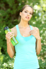 Young woman after long run at park