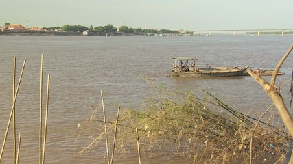 A bamboo raft is  towed by small boat (2)
