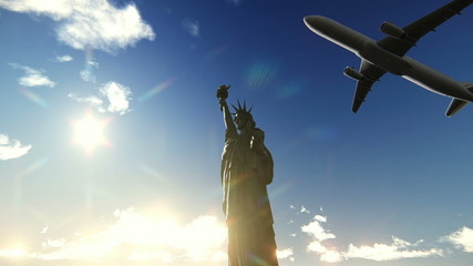 Airplane flying over the Statue of Liberty