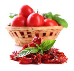 Sun dried tomatoes, fresh tomatoes in wicker basket,  basil