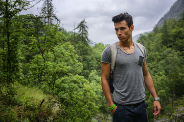 Handsome muscular man backpacking