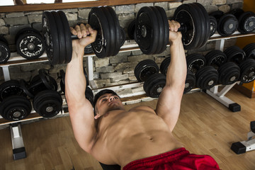 Bodybuilder working out in a gym