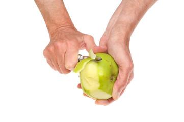 Hands peeling apple